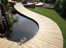 Curved Decked Pathway and Pond